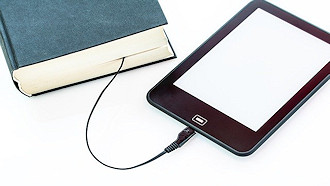 tablet attached to book